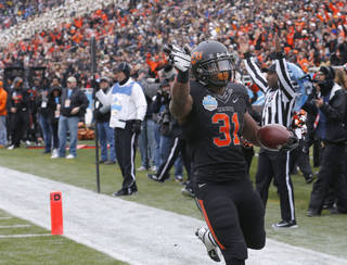 COLLEGE FOOTBALL / BOWL GAME / CELEBRATION: Oklahoma State's Jeremy Smith (31) celebrates a touchdown during the Heart of Dallas Bowl football game between the Oklahoma State University (OSU) and Purdue University at the Cotton Bowl in Dallas, Tuesday,Jan. 1, 2013. Photo by Sarah Phipps, The Oklahoman