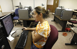 Maribel Flores uses a computer in Oklahoma City Community College's Capitol Hill Center. The college is temporarily using classroom space in Capitol Hill United Methodist Church. Photo By Steve Gooch, The Oklahoman