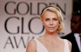 A glitzy headband like this one worn by actress Charlize Theron can add a special touch to a hairstyle. AP Photo.