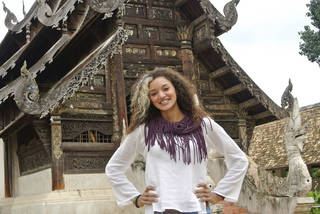 Above: DeEtta Cravens, an Oklahoma City University alumna and a 2014 Charles B. Rangel International Affairs Graduate Fellowship winner, stands in front of a temple in northern Thailand. Photo Provided Photo Provided