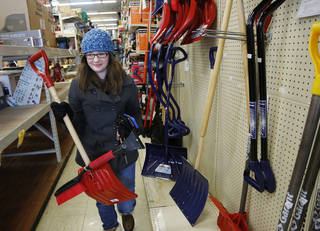 Coleen Riley selects a snow shovel at an Ace Hardware store in West Lafayette, Ind. AP Photo John Terhune - AP