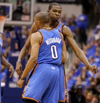 Oklahoma City's Russell Westbrook (0) and Oklahoma City's Kevin Durant (35) celebrate during Game 3 of the first round in the NBA playoffs between the Oklahoma City Thunder and the Dallas Mavericks at American Airlines Center in Dallas, Thursday, May 3, 2012. Photo by Bryan Terry, The Oklahoman