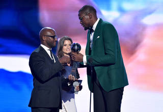 Taye Diggs, left, and Danica Patrick present the award for Best Male Athlete to the Thunder's Kevin Durant at the ESPY Awards in Los Angeles. AP Photo John Shearer