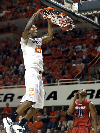 Oklahoma State's Kamari Murphy (21) dunks in front of Toddrick Gotcher (20) during the men's college basketball game between Oklahoma State and Texas Tech at Gallagher-Iba Arena in Stillwater, Okla., Saturday, Feb. 22, 2014. OSU won 84-62. Photo by Sarah Phipps, The Oklahoman