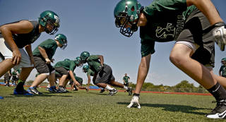 HIGH SCHOOL FOOTBALL: Edmond Santa Fe football players take to the field during the first day of football practice at Edmond Santa Fe High School on Tuesday, Aug. 7, 2012, in Edmond, Okla. Photo by Chris Landsberger, The Oklahoman