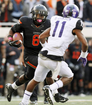 Oklahoma State's Daytawion Lowe (8) returns an interception past TCU's Skye Dawson (11) in the fourth quarter during a college football game between Oklahoma State University (OSU) and Texas Christian University (TCU) at Boone Pickens Stadium in Stillwater, Okla., Saturday, Oct. 27, 2012. OSU won, 36-14. Photo by Nate Billings, The Oklahoman
