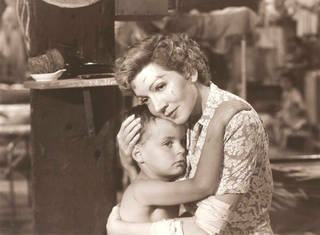 """Claudette Colbert in """"Three Came Home."""""""