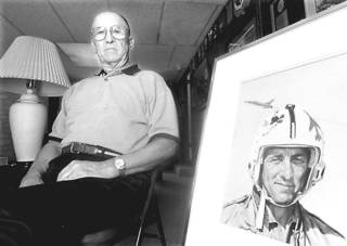 KRT US NEWS STORY SLUGGED: POW KRT PHOTOGRAPH BY JIM SIGMON/DALLAS MORNING NEWS (FORT WORTH OUT) (KRT4- July 19) Vietnam prisoner of war Robinson Risner poses next to the painting that TIME magazine used for its 1965 cover story on American pilots. (DA) AP PL KD 1999 (Horiz) (lde) (Additional photos available on KRT Direct, KRT/PressLink or upon request)-- NO MAGS, NO SALES --