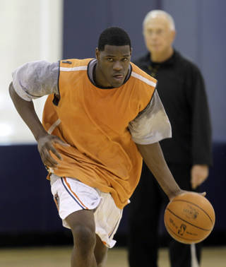 In this photo taken on Monday, June 7, 2010, Latavious Williams brings the ball up the court during a pre-NBA draft workout for the Charlotte Bobcats as Bobcats coach Larry Brown looks on in Charlotte, N.C. Williams could become the first player to go from high school to the D-League to the NBA if he's selected in Thursday's draft. (AP Photo/Chuck Burton) ORG XMIT: NCCB201