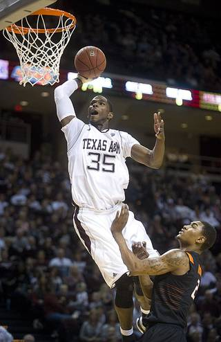 Texas A&M's Ray Turner dunks the ball over Oklahoma State's Le'Bryan Nash uring the first half of an NCAA college basketball game at Reed Arena in College Station, Texas, Saturday, Jan. 28, 2012. (AP Photo/Bryan-College Station Eagle, Stuart Villanueva) ORG XMIT: TXBRY101