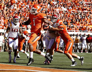 Oklahoma State's Joseph Randle (1) scores a touchdown in the first quarter of a college football game between Oklahoma State University (OSU) and Iowa State University (ISU) at Boone Pickens Stadium in Stillwater, Okla., Saturday, Oct. 20, 2012. Photo by Sarah Phipps, The Oklahoman