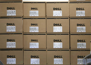 Boxes containing Dell computers are stacked on an upper shelf of a Best Buy store in Seekonk, Mass. AP Photo