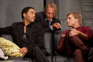 """In this image released by Lionsgate, from left, Lenny Kravitz portrays Cinna, Woody Harrelson portrays Haymitch Abernathy and Josh Hutcherson portrays Peeta Mellark in a scene from """"The Hunger Games."""" (AP Photo/Lionsgate, Murray Close) Murray Close - AP"""