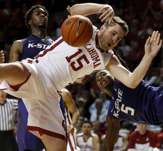 Oklahoma Sooner's Tyler Neal (15) is fouled on a shot by Jevon Thomas as the University of Oklahoma Sooner (OU) men play the Kansas State Wildcats (KS) in NCAA, college basketball at The Lloyd Noble Center on Saturday, Feb. 22, 2014 in Norman, Okla. Photo by Steve Sisney, The Oklahoman