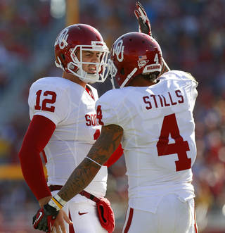 Oklahoma's Landry Jones (12) and Kenny Stills (4) celebrate after a touchdown during a college football game between the University of Oklahoma (OU) and Iowa State University (ISU) at Jack Trice Stadium in Ames, Iowa, Saturday, Nov. 3, 2012. Oklahoma won 35-20. Photo by Bryan Terry, The Oklahoman
