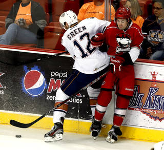 HOCKEY / AMERICAN HOCKEY LEAGUE / PLAYOFFS / OKLAHOMA CITY BARONS / CHARLOTTE CHECKERS / COX CONVENTION CENTER: Baron's Josh Green checks Ryan Murphy against the boards in the first period during Game 2 of the AHL hockey playoff series between the Oklahoma City Barons and the Charlotte Checkers at the Cox Center in Oklahoma City, on Saturday, April 27, 2013. Photo by Steve Sisney, The Oklahoman