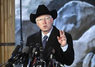 Interior Secretary Ken Salazar gestures during a news conference at the National Zoo in Washington, Thursday, Jan. 20, 2011, during a signing ceremony of a new Giant Panda cooperative research and breeding agreement for five more years. AP PHOTO