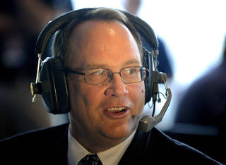 Big 12 Commissioner Dan Beebe speaks during a radio interview at the NCAA college football Big 12 Media Days, Tuesday, July 26, 2011, in Dallas. (AP Photo/Matt Strasen)
