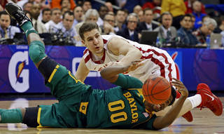 Oklahoma's Tyler Neal (15) dives for the ball beside Baylor's Royce O'Neale (00) during the Big 12 Tournament college basketball game between the University of Oklahoma and Baylor at the Sprint Center in Kansas City, Mo., Thursday, March 13, 2014. Baylor won 78-73. Photo by Bryan Terry, The Oklahoman
