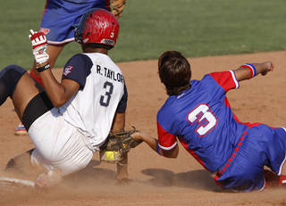 Team USA's Rhea Taylor (3) slides into second past Puerto Rico's Kiara Nazario (3) during a World Cup of Softball game between USA and Puerto Rico at ASA Hall of Fame Stadium in Oklahoma City, Thursday, June 28, 2012. Photo by Garett Fisbeck, The Oklahoman