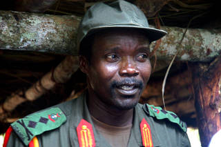 FILE - In this July 31, 2006 file photo, Joseph Kony, leader of the Lord's Resistance Army, speaks during a meeting with a delegation of 160 officials and lawmakers from northern Uganda and representatives of non-governmental organizations in Congo near the Sudan border. The African Union said Friday, March 23, 2012 it will send 5,000 soldiers to join the hunt for war criminal Joseph Kony, a new mission that comes amid a wildly popular Internet campaign targeting the leader of the Lord's Resistance Army. (AP Photo, File) ORG XMIT: AAS102