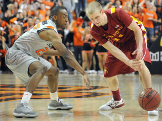 Oklahoma State guard Markel Brown (22) slaps the ball away from Iowa State's guard Scott Christopherson (11) during the second half of an NCAA college basketball game, Tuesday, Feb. 7, 2012, in Stillwater, Okla. (AP Photo/The NewsPress, Chris Day) ORG XMIT: OKSTI202