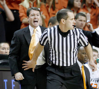 OSU coach Travis Ford shouts from behind an official during the NCAA college basketball game between Oklahoma State and Texas in Stillwater, Okla., Saturday, Feb. 28, 2009. PHOTO BY BRYAN TERRY, THE OKLAHOMAN