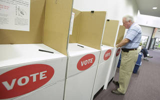 Norman Neaves, of Oklahoma City, in the voting booth at precinct 416 in Oklahoma City in 2010. In the April 2016, Democrats allowed voters registered independent to cast ballots their party's primary election. The Oklahoman Archives