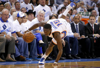 Oklahoma City's Reggie Jackson (15) maintains control of the ball along the edge of the court during Game 5 in the second round of the NBA playoffs between the Oklahoma City Thunder and the Memphis Grizzlies at Chesapeake Energy Arena in Oklahoma City, Wednesday, May 15, 2013. Photo by Bryan Terry, The Oklahoman