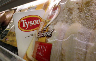 In this May 3, 2009 file photo, Tyson Foods chicken products are displayed on the shelves of a Little Rock, Ark. grocery store. Tyson Foods Inc. on Monday, Aug. 3, 2009 posted a strong third-quarter profit, powered by its poultry division, but beef and pork also made money as the world's largest meat producer finally overcame last year's steep increases in feed and fuel prices. (AP Photo/Danny Johnston, file)