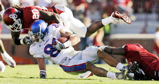OU's Quinton Carter brings down Kansas' Johnathan Wilson. Carter led the Sooners with 10 tackles in a 45-31 win. Photo BY NATE BILLINGS, THE OKLAHOMAN