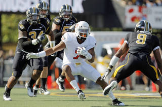 Oklahoma State's Michael Harrison (7) tries to get past Missouri's Braylon Webb (9) in the first quarter during a college football game between the Oklahoma State University Cowboys (OSU) and the University of Missouri Tigers (Mizzou) at Faurot Field in Columbia, Mo., Saturday, Oct. 22, 2011. Photo by Nate Billings, The Oklahoman ORG XMIT: KOD