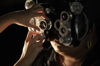 A free eye exam is performed on a patient at the Remote Area Medical (RAM) clinic inside the Los Angeles Sports Arena in Los Angeles. (AP Photo/Damian Dovarganes, File) Damian Dovarganes - AP