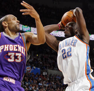 Oklahoma City's Jeff Green tries to get the ball past Phoenix's Grant Hill during the Thunder's 104-102 loss Tuesday at the Ford Center. PHOTO BY NATE BILLINGS, THE OKLAHOMAN