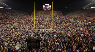Iowa State fans flood the field after a college football game between the Oklahoma State University Cowboys (OSU) and the Iowa State University Cyclones (ISU) at Jack Trice Stadium in Ames, Iowa, Saturday, Nov. 19, 2011. Iowa State won, 37-31, in double overtime. Photo by Nate Billings, The Oklahoman