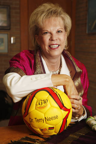 Terry Neese, who works with women in Rwanda and Afghanistan to help them build businesses, poses with a soccer ball at her office in Oklahoma City on Wednesday, April 11. The ball was made in Afghanistan. THE OKLAHOMAN DOUG HOKE DOUG HOKE - THE OKLAHOMAN