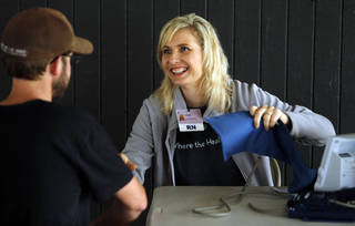 Norman Regional Hospital nurse Amber Browning gives free blood pressure checks Friday at a Bike to Work rally at Andrews Park. PHOTO BY STEVE SISNEY, THE OKLAHOMAN STEVE SISNEY