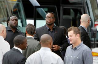 Tampa Bay Buccaneers guard Davin Joseph, left, and defensive tackle Gerald McCoy, center, arrive with the rest of the team for a memorial service former Tampa Bay Buccaneers football player and Hall of Famer Lee Roy Selmon at Idlewild Baptist Church in Lutz, Fla. on Friday, Sept. 9, 2011. (AP Photo/St. Petersburg Times, Daniel Wallace) TAMPA OUT; CITRUS COUNTY OUT; PORT CHARLOTTE OUT; BROOKSVILLE HERNANDO TODAY OUT ORG XMIT: FLPET202