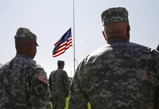 Soldiers with the 45th Infantry Brigade stand at attention as the names of those killed during the unit's recent deployment to Afghanistan are read during a Memorial Day service in May. OKLAHOMAN ARCHIVE photo