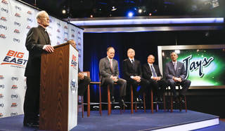 Rev. Brian Shanley, far left, Providence University President, John DeGioia, fourth from right, Georgetown University President, Randy Freer, third from right, FOX Sports President and COO, Larry Jones, second from right, and FOX Sports V.P. and Madison Square Garden Executive Vice President Joel Fisher, far right, hold a press conference on Wednesday, March 20, 2013 in New York. Big East athletic conference member schools gathered in New York to announce developments helping to shape the new basketball-focused conference. (AP Photo/Bebeto Matthews) ORG XMIT: NYBM101