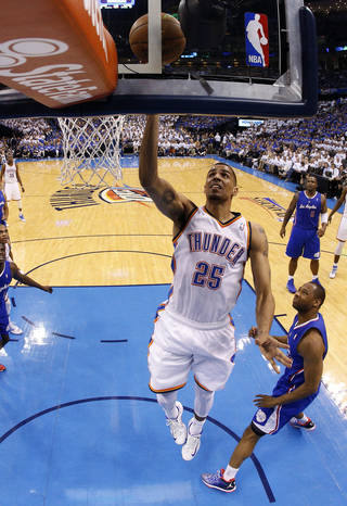 Oklahoma City's Thabo Sefolosha (25) shoots a lay up during Game 2 of the Western Conference semifinals in the NBA playoffs between the Oklahoma City Thunder and the Los Angeles Clippers at Chesapeake Energy Arena in Oklahoma City, Thursday, May 8, 2014. Photo by Sarah Phipps, The Oklahoman