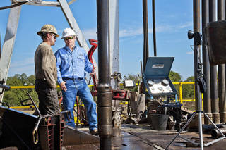 FILE - In this photo provided Oct. 9, 2012, Continental Resources Inc. crews drill for oil near Chickasha.