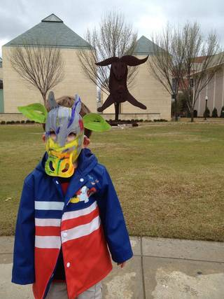 A local child wears a mask he created during a spring Family Day at the Fred Jones Jr. Museum of Art. The museum presents a free showing of the 1994 animated film, The Lion King, at10:30 a.m. Saturday, June 9, followed by a free Family Day 1-4 p.m. Sunday, June 10. Children must be accompanied by an adult. Photo provided.