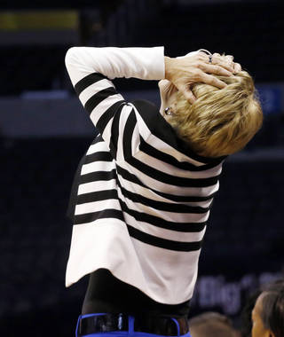 Baylor head coach Kim Mulkey grabs her head in reaction to a call in the second half of an NCAA college basketball game against Oklahoma State in the semifinals of the Big 12 Conference women's college tournament in Oklahoma City, Sunday, March 9, 2014. Baylor won 65-61. (AP Photo/Sue Ogrocki)