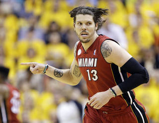 FILE - In this June 1, 2013, file photo, Miami Heat shooting guard Mike Miller reacts to play against the Indiana Pacers during the second half of Game 6 of the NBA Eastern Conference basketball finals in Indianapolis. The Heat are designating Miller as their amnesty player, a move that may save more than $30 million in luxury tax payments over the next two years. Miller tells The Associated Press he understands the move, though he's disappointed to leave a championship club. (AP Photo/Michael Conroy, File) ORG XMIT: NY161