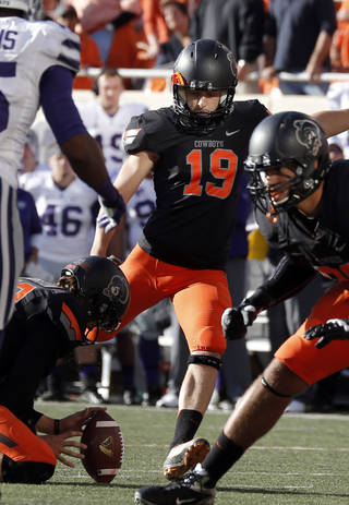 Oklahoma State's Ben Grogan (19) kicks a field goal in the third quarter during the second half of a college football game between the Oklahoma State University Cowboys (OSU) and the Kansas State University Wildcats (KSU) at Boone Pickens Stadium in Stillwater, Okla., Saturday, Oct. 5, 2013. OSU won 33-29.Photo by Sarah Phipps, The Oklahoman