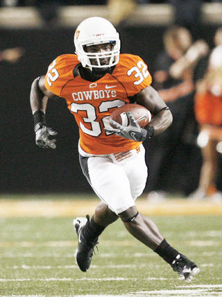 Oklahoma State's Travis Miller had 13 carries for 59 yards in 2009, and he could greatly benefit from new coordinator Dana Holgorsen's offense. Photo by Nate Billings, The Oklahoman