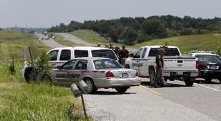 Police and OHP have blocked State Highway 9 both ways east of Pennsylvania as a woman with a gun was reported on the north service road near an antique store. on Thursday, July 18, 2013 in Newcastle, Okla. Photo by Steve Sisney, The Oklahoman