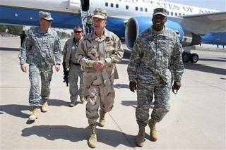 In this image released by the US Department of Defense, Chairman of the Joint Chiefs of Staff Adm. Mike Mullen is greeted by U.S. Army Gen. Lloyd Austin, commander, U.S. Forces-Iraq upon is arrival at Forward Operating Base Marez, Mosul, Iraq, on Aug. 1, 2011. (AP Photo/MC1 Chad J. McNeeley - US Department of Defense)