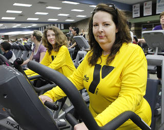 Christi Williams, right, and daughter Allyssa, 11, work out at the Earlywine YMCA. Christi is in the Livestrong program for cancer survivors. Photo By David McDaniel, The Oklahoman